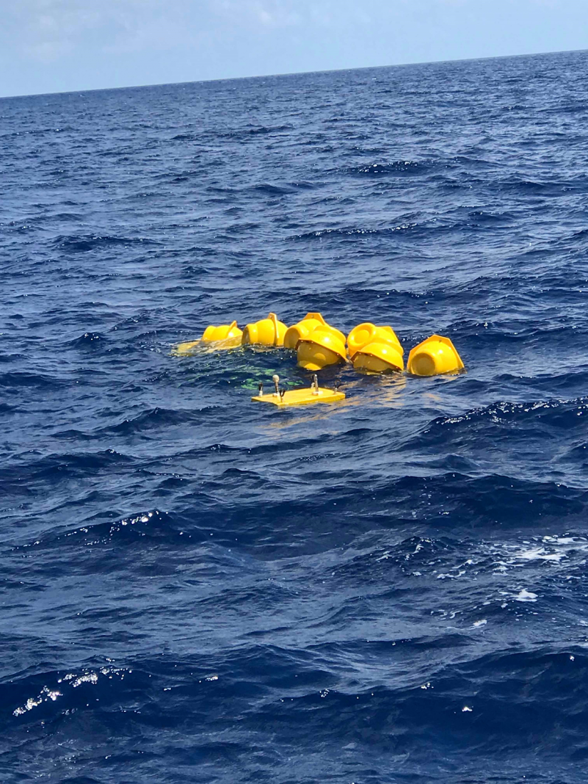A yellow device floating in the water.