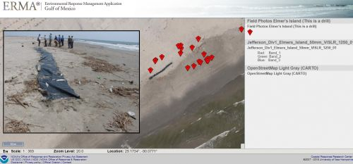 An ERMA screenshot with an image showing a black tarp on a beach to simulate oil.