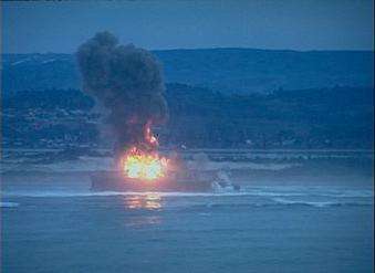 A vessel on fire.