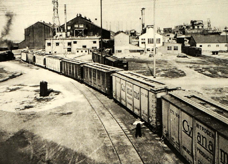 "A black and white photo of a train with cars labeled ""Cyanamid Company."""
