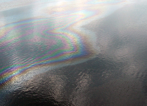 An aerial view of an oil sheen in a body of water.
