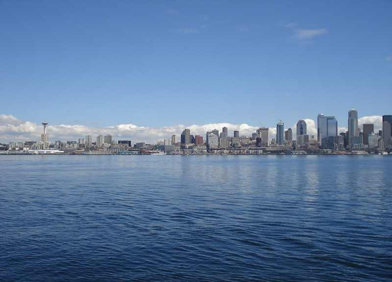 A view of the Puget Sound with the Seattle skyline in the background.
