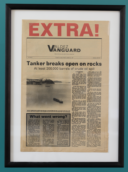 "A newspaper clipping with the headline ""Tanker breaks open on rocks."""