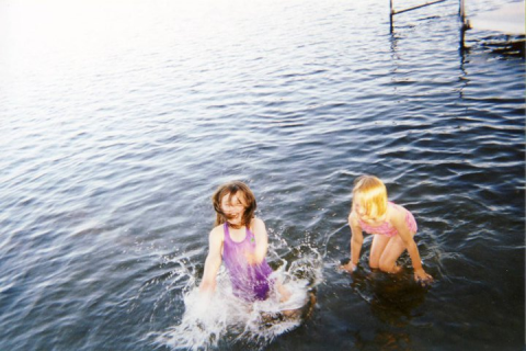 Two children in a body of water.