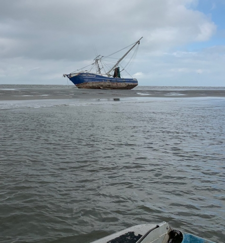 A vessel grounded on a sand bar.