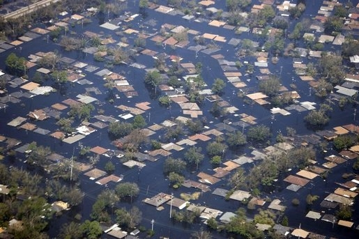 An aerial view of a flooded residential area.