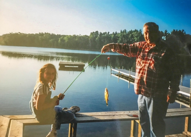 A man and a little girl fishing.