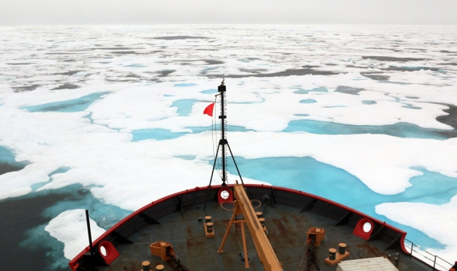 Image of an icebreaker moving through ice.