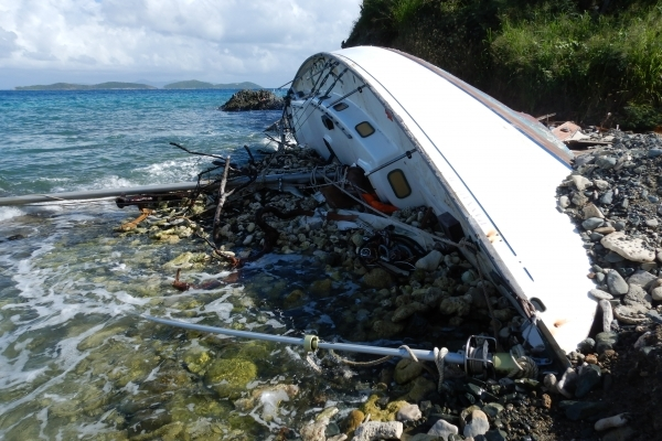 An overturned beached vessel.
