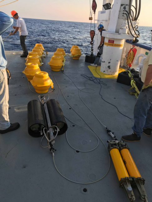 A yellow device aboard a vessel.