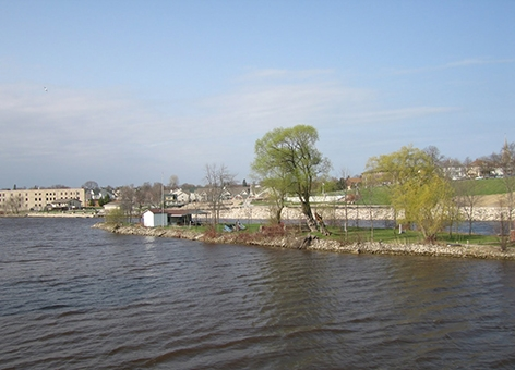 A river with an urban area in the background.