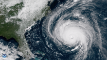 A satellite image of a hurricane approaching the southeastern United States.