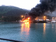 A vessel on fire.