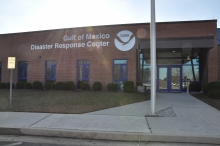 "A building with a sign that reads ""Gulf of Mexico Disaster Response Center."""