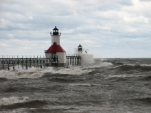 Waves crashing into a lighthouse.