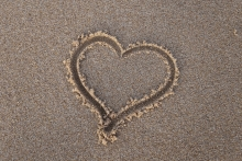 A heart drawn in sand.