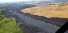 An aerial image of a river of black lava.