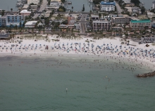 An aerial view of a beach with people on it.