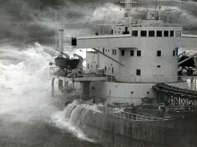 An old black and white photo of water covering the deck of a vessel.