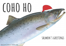 "A salmon wearing a santa hat that reads ""Coho Ho."""