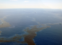 An aerial view of an oil sheen in water.