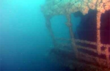 An underwater image of a sunken vessel.