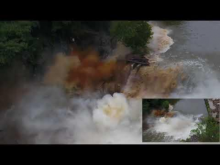 Two images, a smaller one overlapping in the corner, of a dam being blown up.