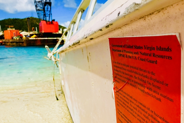 A red notice on a grounded vessel.