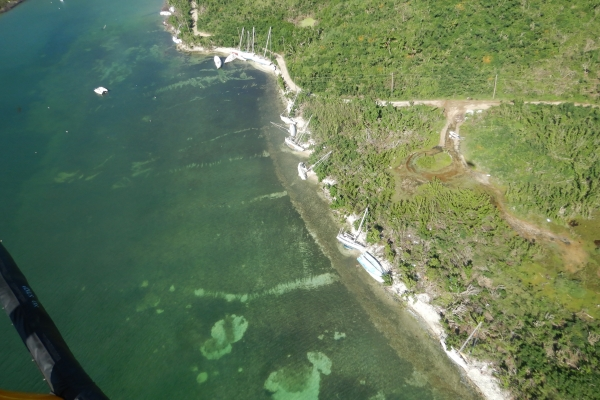 An aerial view of grounded vessels along a shoreline.